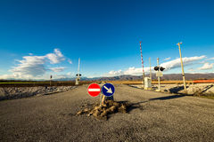 Railroad crossing with mountains behind Royalty Free Stock Images