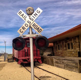 Railroad Crossing. An old railroad station with crossing sign in Ft. Stockton, Texas Royalty Free Stock Photos