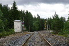 Railroad crossing with red light. Road crossing a railroad track in Norway Stock Image