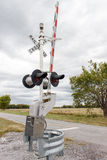Railroad crossing on rural road Stock Images