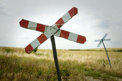 Railroad crossing sign. In the field Stock Image