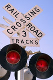Railroad Crossing Sign. Flashing railroad crossing sign, at dusk Royalty Free Stock Photography