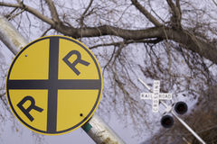 Railroad crossing sign. Bright railroad crossing sign at an angle Stock Photos