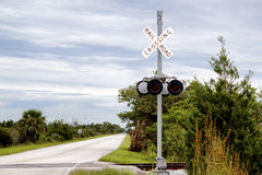 Railroad Crossing Sign. Lonely railroad crossing sign on the back roads of Merritt Island, nera Kennedy Space Center. The image shows the sign / sign post royalty free stock photography