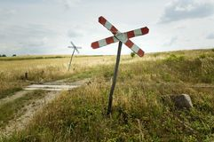 Railroad crossing sign. Rural scene with a railroad crossing sign Stock Photos