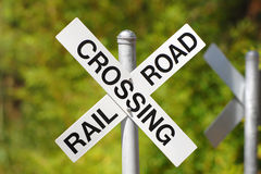 Railroad Crossing Sign. Warns car traffic of pending danger stock photography