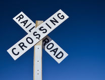 Railroad crossing sign. Against a blue sky Royalty Free Stock Image