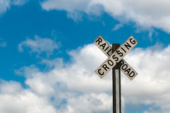 Railroad Crossing Sign Against Cloudy Sky Royalty Free Stock Image