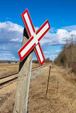 Railroad crossing sign along gravel road.  Stock Photography