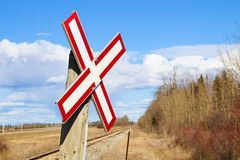 Railroad crossing sign along gravel road.  Royalty Free Stock Photography