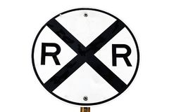 Railroad Crossing Sign. A black and white isolated railroad crossing sign royalty free stock image