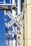Railroad crossing sign with blue sky royalty free stock photography