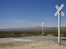 Railroad crossing sign. In the desert Royalty Free Stock Photo