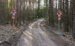 Railroad crossing sign in middle of the forest Stock Image