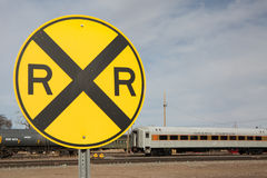Railroad Crossing Sign and Railcar. A yellow railroad crossing sign Stock Image