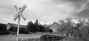 Railroad Crossing Sign Rural Countryside Mt Shasta California. A black and white representation of a rural scene in high mountains of California Stock Image