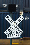 Railroad Crossing sign with Shipping Container Train in Backgrou Royalty Free Stock Photography