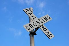 Railroad crossing. Sign with a slightly cloudy sky Royalty Free Stock Photos