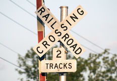 Railroad crossing sign with 2 tracks Royalty Free Stock Photos