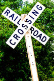 Railroad crossing sign. On a wood post Stock Images