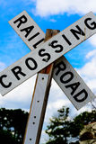 Railroad crossing sign. On a wood post Stock Photo