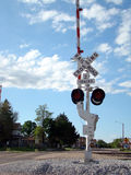 Railroad Crossing Signal. In small town Stock Images