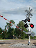 Railroad Crossing Signal. In small town Stock Photography