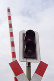 Railroad crossing signal light and open bar Royalty Free Stock Photography