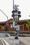 Railroad crossing signal, in portuguese. Railroad crossing signal, in the city of Guararema, in the countryside of the Sao Paulo state, Brazil. Write in Stock Images
