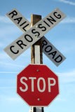 Railroad Crossing Stop Sign. Stop sign at railroad crossing on clear day with blue sky stock image