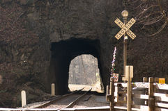 Railroad Crossing at tunnel Royalty Free Stock Photography