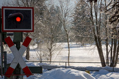 Railroad crossing in winter Stock Images