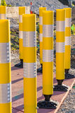 Railroad crossing yellow safety tubes reflecting the sunrise. Several railroad crossing yellow safety tubes reflecting the sunrise royalty free stock photos