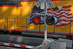 Railroad crossing2. Speeding locomotive train going past railroad crossing Stock Photo