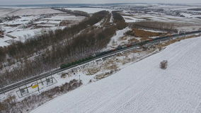 Railroad delivery. Freight train with cargo vagons and tanks passing by. Aerial. stock video