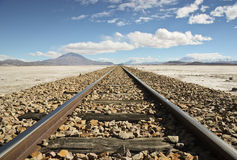 Railroad in the Desert. Railroad Track through the Atacama Desert in Bolivia Royalty Free Stock Images