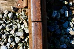 Railroad details. Details of rails and rocks with shadows and contrast Royalty Free Stock Photo