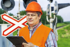 Railroad employee with folder Royalty Free Stock Image