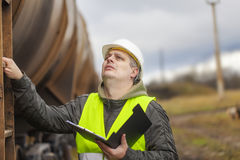 Railroad employee near the tank wagons Royalty Free Stock Photography
