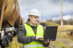 Railroad employee with PC Stock Photography
