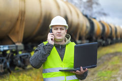 Railroad employee with phone and PC Stock Photos