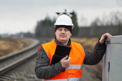 Railroad employee with tablet PC Stock Image