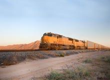 Railroad engine crossing Arizona stock images