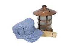 Railroad engineer hat and lantern Stock Photos