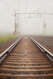 Railroad in fog Stock Image