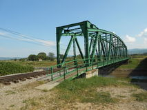 Railroad and footbridge over the river Stock Image