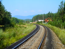 Railroad. The railroad between the forest and the village in front Stock Photography