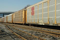 Railroad Freight Train. Passing railroad train of auto carriers Royalty Free Stock Photos