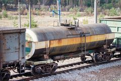 Railroad and freight train with rusty railway wagons going along forest. Transportain, cargo concept.  Royalty Free Stock Photo