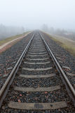 Railroad goes into the mist. gray misty autumn morning. Stock Images